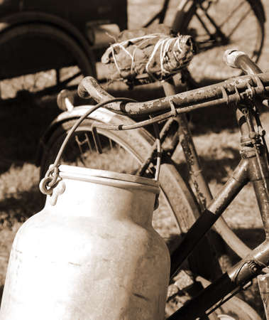 milkman: Old bicycle of milkman and the Milk Canister Stock Photo