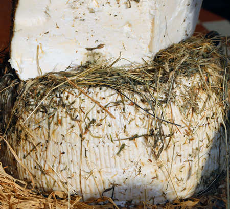 hard sell: genuine alpine cheese is aged between hay and straw Stock Photo