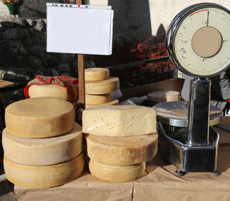 hard cheese: hard cheese and a balance in the local market Stock Photo