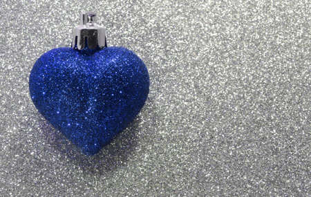 red glittery: big lone heart in the glitter background