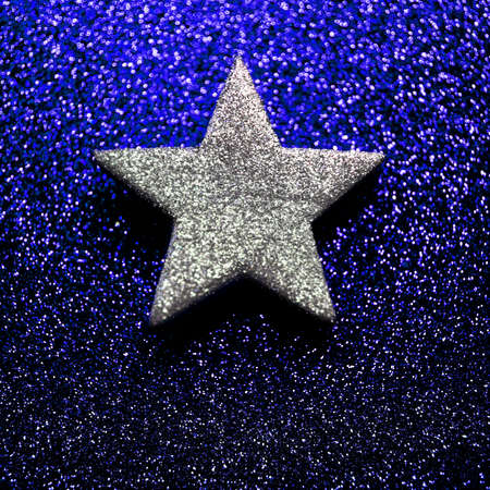 twinkles: lonely five-pointed star in the glittering golden background