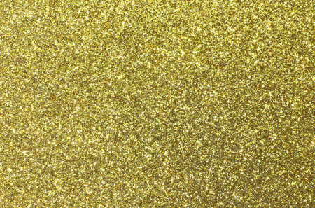 gaudy: yellow background shining uniformly colored gold glitter