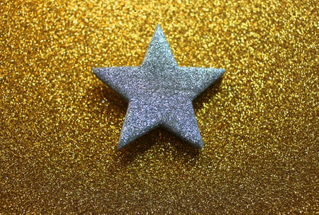 gaudy: lone bright star on golden shiny background Stock Photo