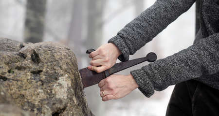 inconvenient: Hand of the valiant knight tries to remove the magical Excalibur sword in the stone