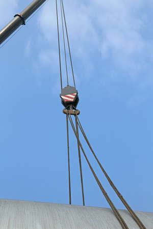 loads: giant pulley with sturdy steel cables to lift heavy loads during loading