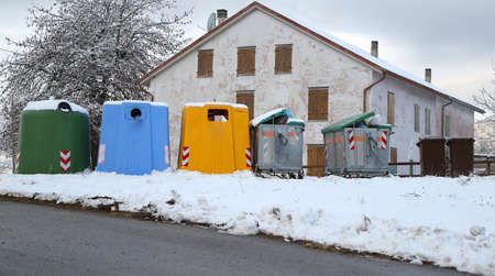 receptacle: many bins for the collection of waste in the mountain town Stock Photo