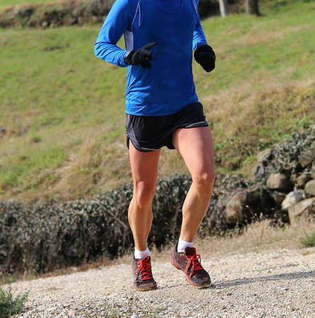 open country: muscular legs of the fast runner during the cross country Championships in open country