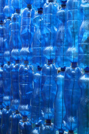 repurpose: many blue plastic bottles to recycle Stock Photo
