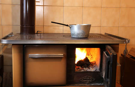 woodburning: old wood-burning stove in the kitchen of home