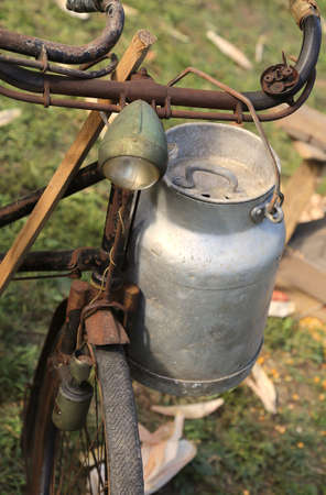 milkman: old aluminum milk churn used by farmers to bring fresh milk