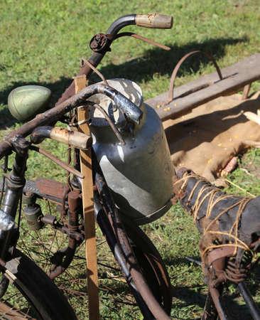 milkman: old Milk Canister and rusty historic bike of milkman