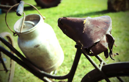 milkman: Old rusty bicycle of milkman and the Milk Canister Stock Photo