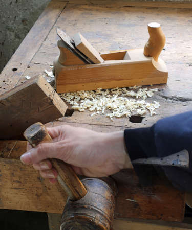 carpenter vise: Carpenters hand in the carpentry workshop with Workbench vise Stock Photo