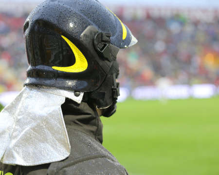 hardhat: firefighters with hardhat in riot gear during the sports event
