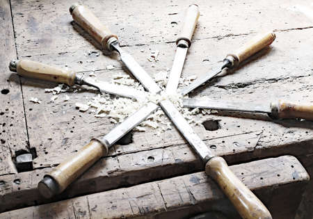 chisels: series of many sharp steel blades many chisels Stock Photo