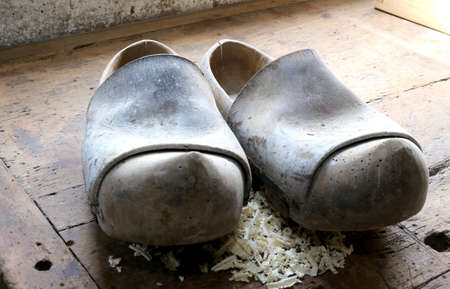 clogs: two ancient wooden clogs in the workshop of a shoemaker Stock Photo
