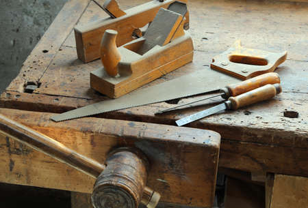 carpenter vise: crosscut hand saw Planer and other tools of a carpenter for woodworking