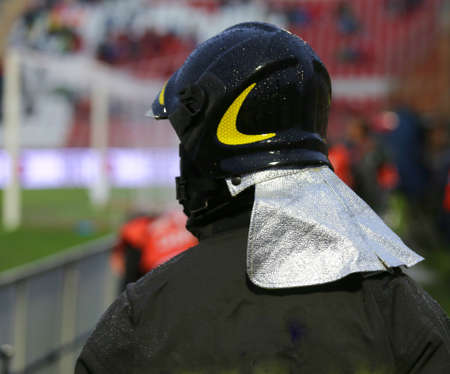 hardhat: fireman with hardhat during the sports event at the stadium Stock Photo