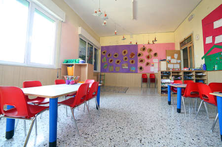 day care center: inside of the kindergarten classroom with drawings on the walls