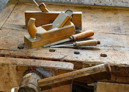 chisels: planes and chisels in the Workbench with a wooden grip inside the craftsman joinery manufacturer