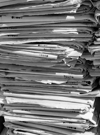 repurpose: newspapers will become recycled paper leading them in Binder in the EcoCentre