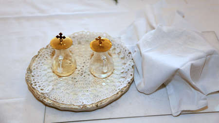 baptize: glass Cruets for the blessing of the wine during a religious rite Stock Photo