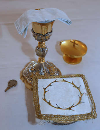 chalice: Golden Chalice in the altar of a Christian Church during Holy Mass Stock Photo