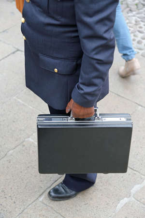bribes: corruption. Dirty COP with leather glove and the case after payment of a bribe Stock Photo
