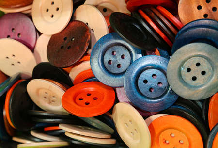 modiste: many wooden and plastic buttons on sale in the shop of crafts and decoupage