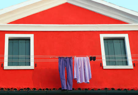 launderette: just washed laundry and lots of clothes hung out to dry in the House in Italy