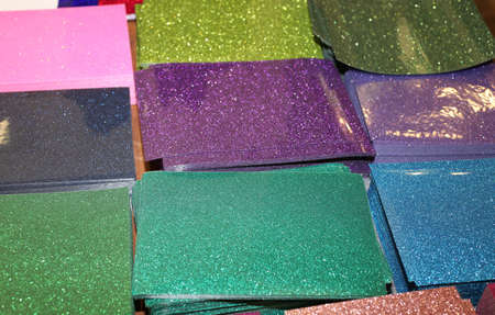 embellishments: many sheets of glossy paper with glitter on sale in the shop of decoupage and embellishments