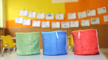 kiddy: three colored containers for childrens toys in the kindergarten Stock Photo