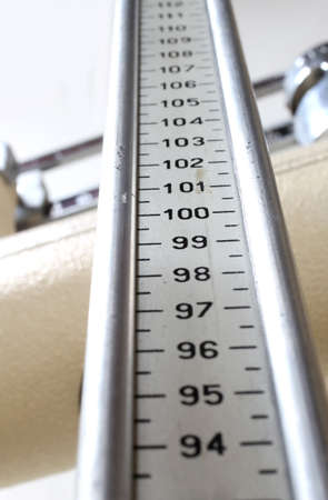 medical checkup: long measuring rod for measuring the height in an ancient scale during the medical check-up control