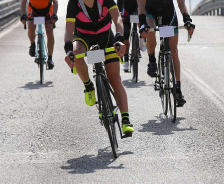 road cycling: Female cyclist and other cyclists with fast race bike during the cycling race on asphalt road