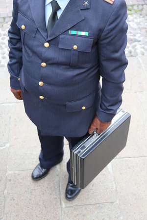 bribes: dirty cop with the suitcase full of money after payment of a bribe