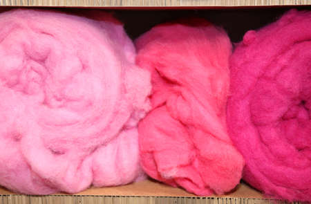 soft sell: three balls of very soft wool for sale in the wholesalers shop Stock Photo