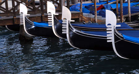 gondolas: four prows of Venetian gondolas with the characteristic shape