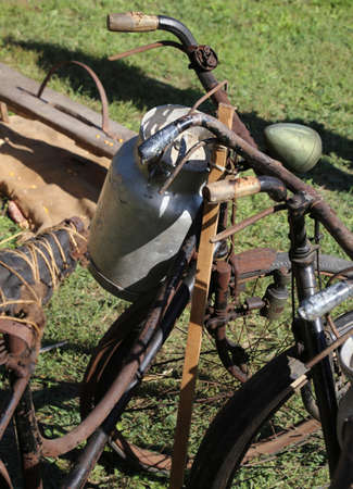 milkman: old Milk Canister and rusty historic bike of milkman