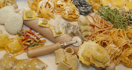 semolina pasta: many sizes of fresh pasta made at home by a good housewife Stock Photo