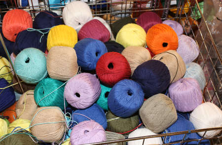 heap of many balls of soft wool for sale in the wholesalers shop