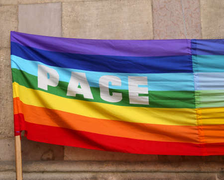 errand: rainbow Peace flag with big written PACE in italy Stock Photo