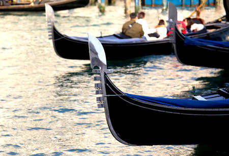 saint marks square: Venetian gondolas sail the Adriatic Sea near Saint Marks square in Venice in Italy