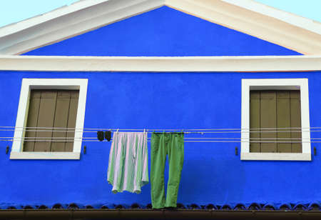 launderette: clothes hung out to dry in the Burano Island near Venice in Italy
