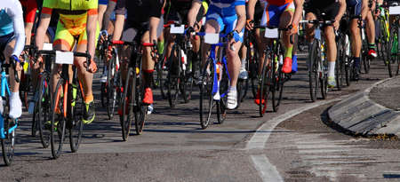 road cycling: many cyclists with fast race bike during the cycling race on asphalt road Stock Photo