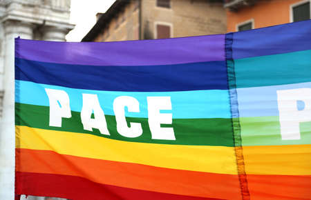 activists: rainbow peace flag during a demonstration of peace activists in an Italian city