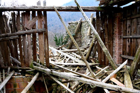 quake: wooden planks and rubble and the ruins of the house completely destroyed by powerful earthquake