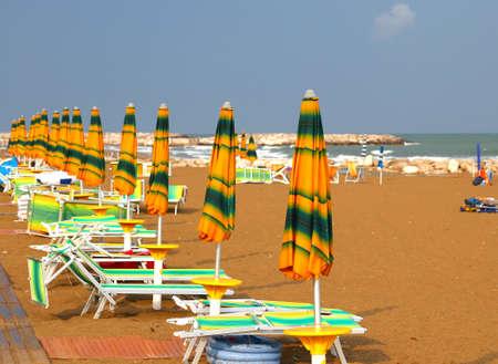 sun umbrellas: Sun umbrellas and loungers in the deserted Beach in summer