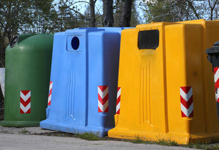 repurpose: big bins for waste paper collection and for the collection of used plastic and glass bottle Stock Photo
