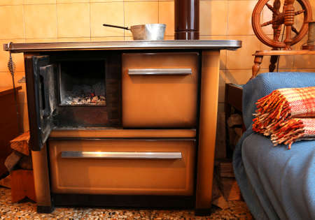 wood burner: old wood-burning stove in the kitchen