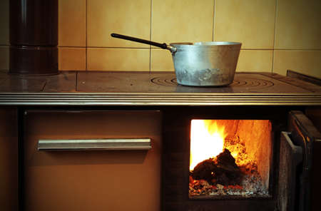 woodburning: old wood-burning stove in the kitchen of mountain home
